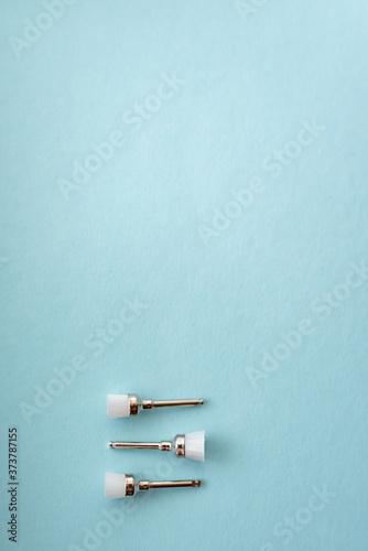 Photo set of dental burs for polishing fillings on a blue background