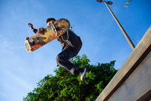 Skater Man Jumps With His Skat...