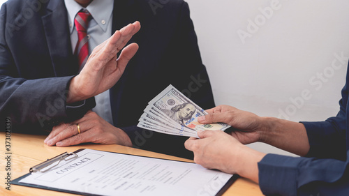 Obraz na plátně Confident businessman manager rejecting an offer of money to agreement contract from partner or refusing to take bribe, Bribery and corruption concept