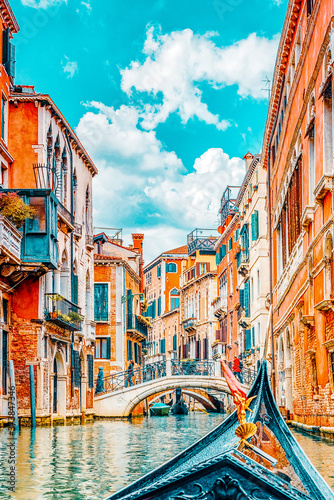 Slika na platnu Views of the most beautiful channels of Venice, front of the boat the gondola, floating along the canal