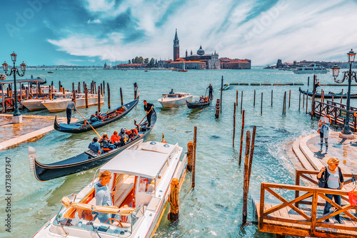Fényképezés VENICE, ITALY - MAY 12, 2017 : Embankment of the Grand Canal with Gondolas and Gondoliers