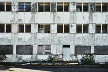 Abandoned Former Administration Building, Slowly Decaying, Without Windows And Panes, Ugly, Weathered
