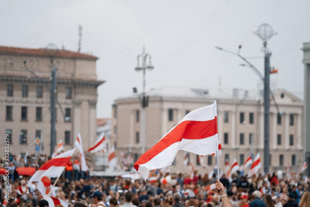 Fototapeta MINSK, BELARUS - August 23, 2020:  March of New Belarus in Minsk. Flag of Belarus. White red white