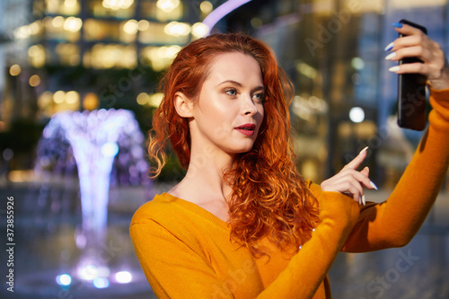 Selfie time, Young funky blogger is making photo for her social networks page Canvas Print