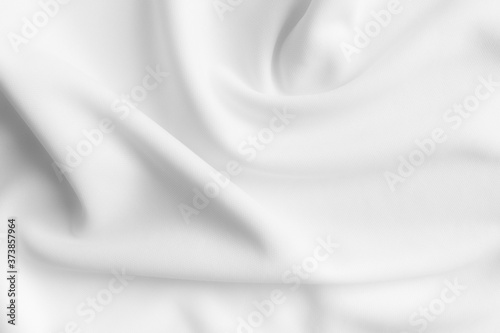 Fotografiet White abstract wavy clothes background. fabric texture