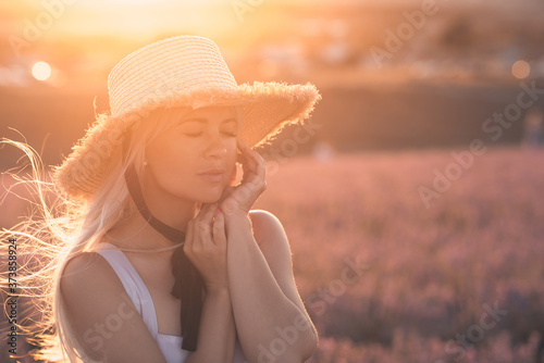 Carta da parati Young beautiful blonde woman 24-26 year old wearing straw hat with laces posing with eyes closed in meadow over nature background