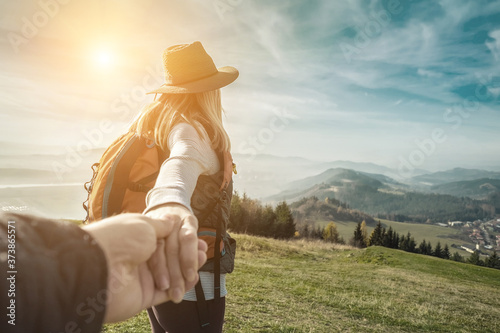 Fotomural Woman hiker, hiking backpacker traveler camper walking on the top of mountain in sunny day under sun light