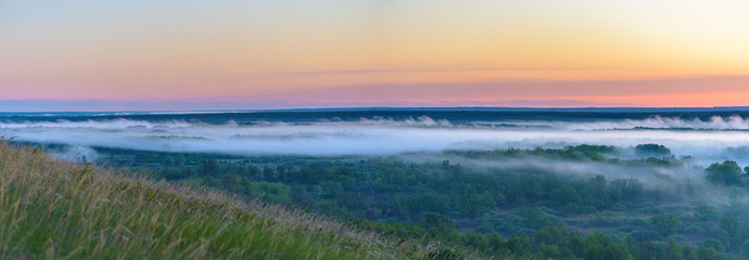 sunrise, fog over the river panorama of the landscape in the early morning. pink sky before sunrise . background image