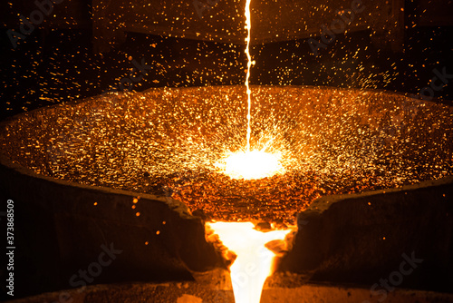 Photo Pouring liquid metal from arc furnace