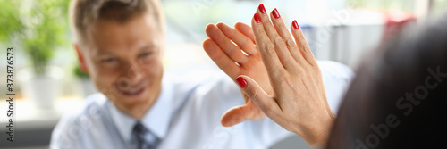 Businessman in an office high five of his colleague a closeup Tableau sur Toile