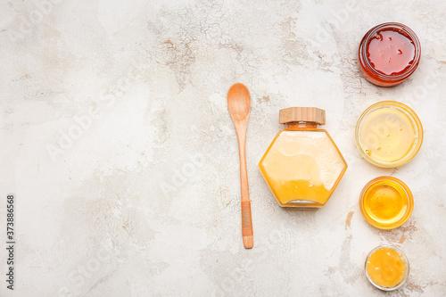 Fototapeta Assortment of tasty honey on grey background