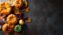 Autumn Background Decor From Pumpkins, Berries, Red Apples And Leaves On Dark Stone Background. Flat Lay, Top View With Copy Space For Autumn, Fall, Thanksgiving And Halloween Concept.