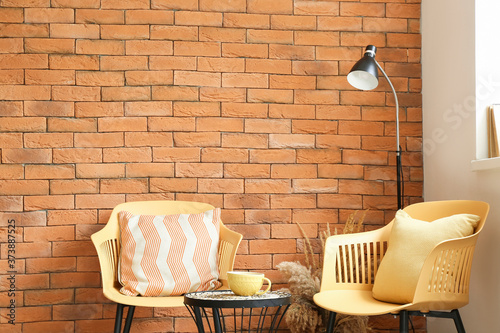Stylish interior of living room with table and chairs Fototapeta