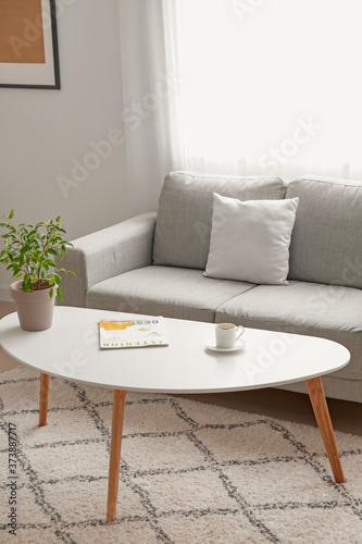 Stylish interior of living room with table and sofa Tapéta, Fotótapéta