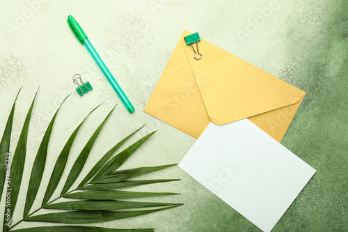 Fotomural Blank card with envelope and stationery on color background