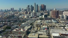 Aerial Decent Of The DTLA Skyline On A Bright Blue Day In California USA
