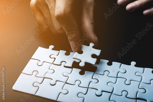 Fotografie, Obraz Missing jigsaw puzzle piece, business concept for completing the final puzzle pi