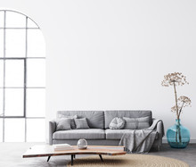 Interior Living Room Design With Simple White Background Mock Up. Modern Grey Sofa With Cushions And Plaid On. Scandinavian Bright Space Concept. 3d Render