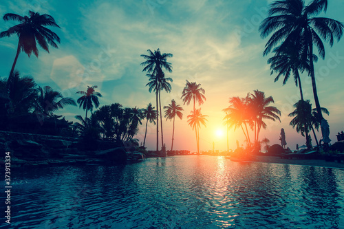 Fantastic sunset, palm trees in tropical beach. Fotobehang