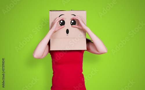 Person with cardboard box on its head and a surprised face expression looking in Canvas-taulu