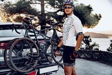 Male Cyclist Loading His Bicyc...