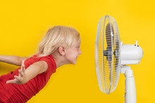 Boy Cools Off With Ventilator....