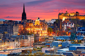 Aerial view of the skyline of Edinburgh with Edinburgh Castle illuminated at sunset