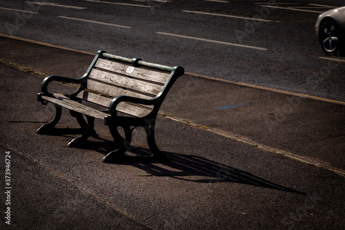 sunlit bench on Brighton sea front Fototapeta