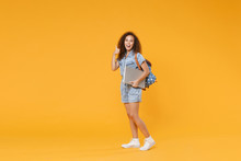 Full Length Portrait Funny African American Girl Student In Denim Clothes, Backpack Isolated On Yellow Background. Education In High School University College. Hold Laptop Computer, Showing Thumb Up.