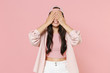 Smiling young asian woman girl in casual clothes cap posing isolated on pastel pink background studio portrait. People emotions lifestyle concept. Mock up copy space. Hiding, covering eyes with hands.