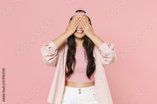 Smiling young asian woman girl in casual clothes cap posing isolated on pastel pink background studio portrait Canvas