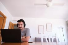 Young Man Wearing Headphones W...