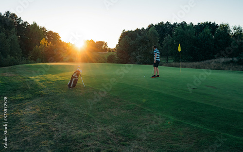 Golfer man character playing golf. Beautiful fairway and layout in forest on hills or mountain and sky. Green golf and light of sun to beauty view for player to happy. Golf sport concept