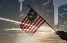American Flag Us Against Modern City Background.