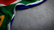canvas print picture - Flag of South Africa on concrete backdrop. South African flag background with copy space