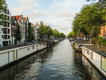 Houseboats In The Canals Of Am...