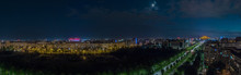 Night Panorama Of Bucharest Wit Huge Building Of Parliament In The Centre. Romania Capital On Summer Night. Evening View Over The Avenue Looking Towards Parliament