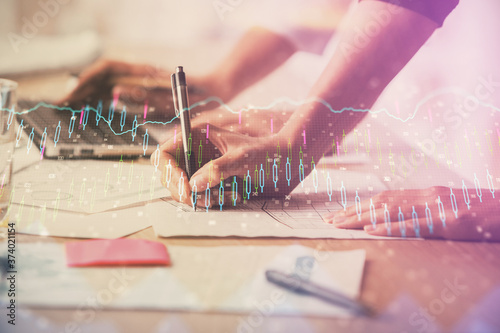Multi exposure of woman hands typing on computer and financial chart hologram drawing Wallpaper Mural