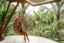 Tourist Woman Swing On Wicker ...