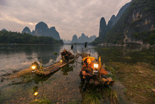 Chinese Traditional Living Habits, Images Of Traveling In Guilin, China, Two Fishermen Relaxing On The Li River.