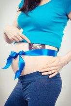 Pregnant Woman With Blue Ribbo...