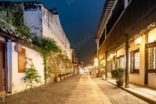 Leinwand Poster At night, the streets of Zhouzhuang Ancient Town, Suzhou, China