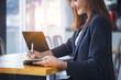 Businesswoman secretary writing information, boss order in notebook before meeting.