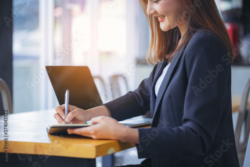 Fotografija Businesswoman secretary writing information, boss order in notebook before meeting