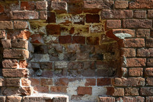 Close-up Section Of The Old Brickwork Of A Red Brick Wall, Part Of The Wall In The Center Of The Frame Is Destroyed.
