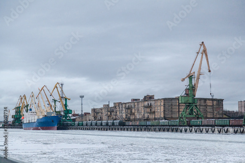 Huge green industrial cranes at the seaport in winter Canvas Print