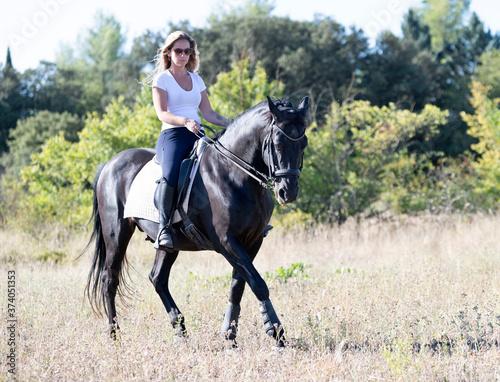 Fototapeta riding girl and horse obraz