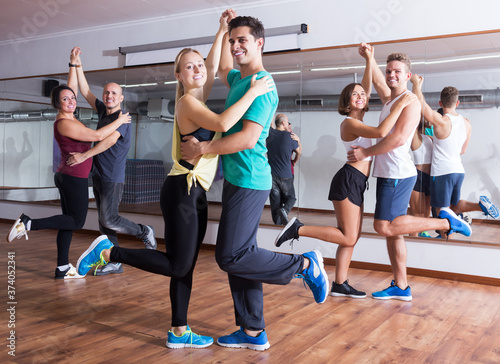 Fotografia, Obraz Dancing couples learning swing at dance class