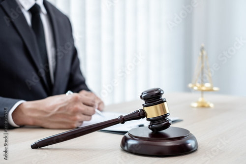 Fotografija Judges gavel, Professional male lawyers work at a law office There are scales, Scales of justice, judges gavel, and litigation documents