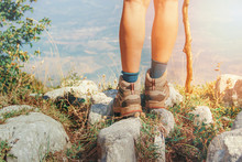Close Up Of Women Legs Wearing Hiking Boots In Mountain
